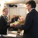 Dr Tim Upson presenting a gift to Mrs Ir Prisca Klein