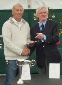 Ken Harrop receives his trophies from Malcolm Bradbury
